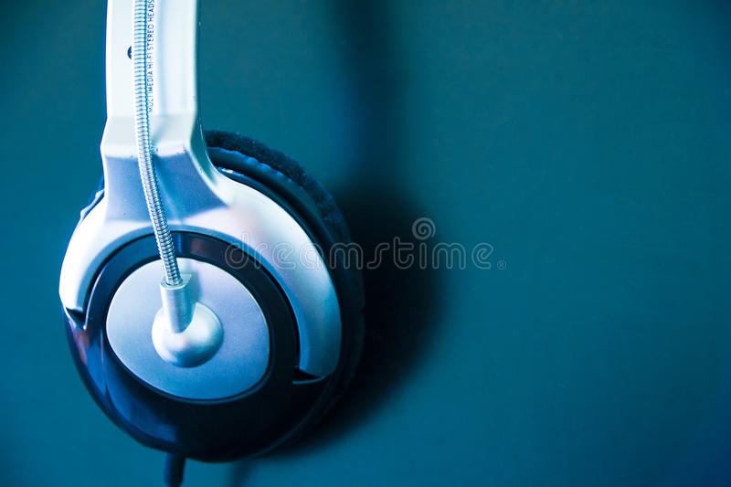 Close up Headphone, earphone hung on computer screen stock images