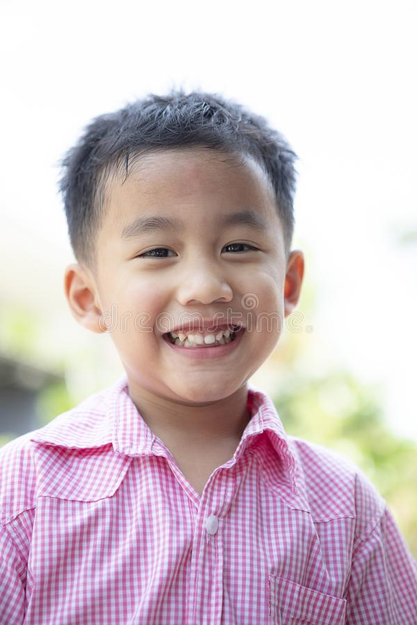 Close up headshot of cheerful asian children toothy smiling face of happiness emotion stock photography