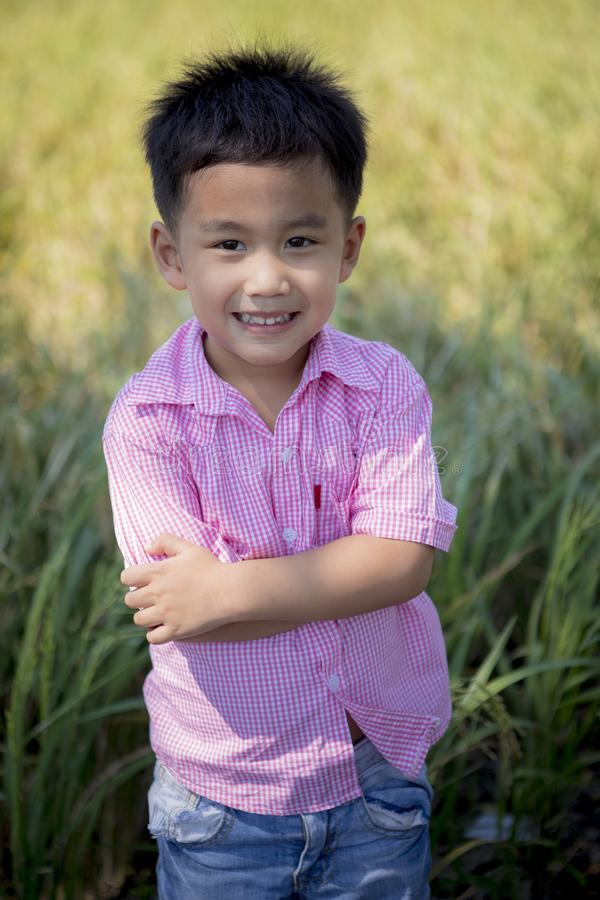 Close up headshot of cheerful asian children toothy smiling face of happiness emotion stock image