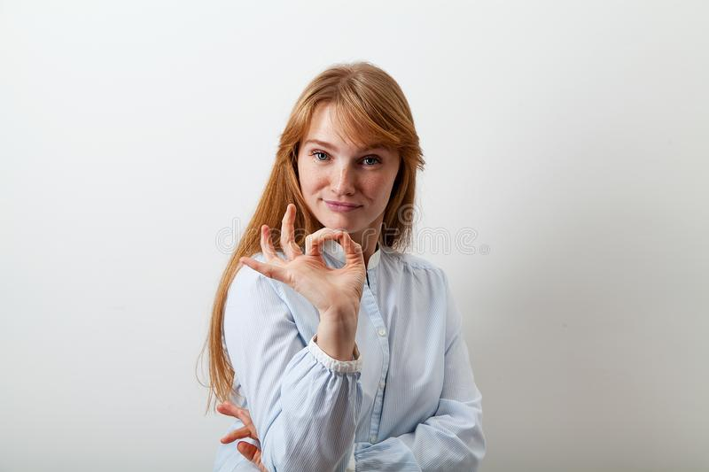 Studio picture of young girl with red hair royalty free stock photo