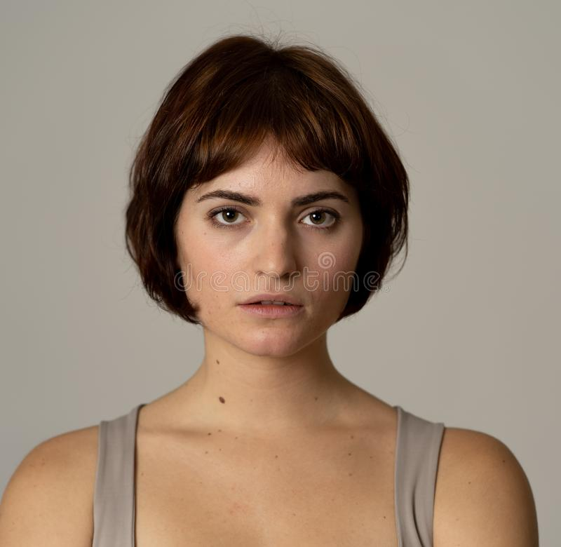 Natural portrait of young attractive woman looking and posing with neutral face expression. Close up headshot of young beautiful caucasian woman with natural and stock photography