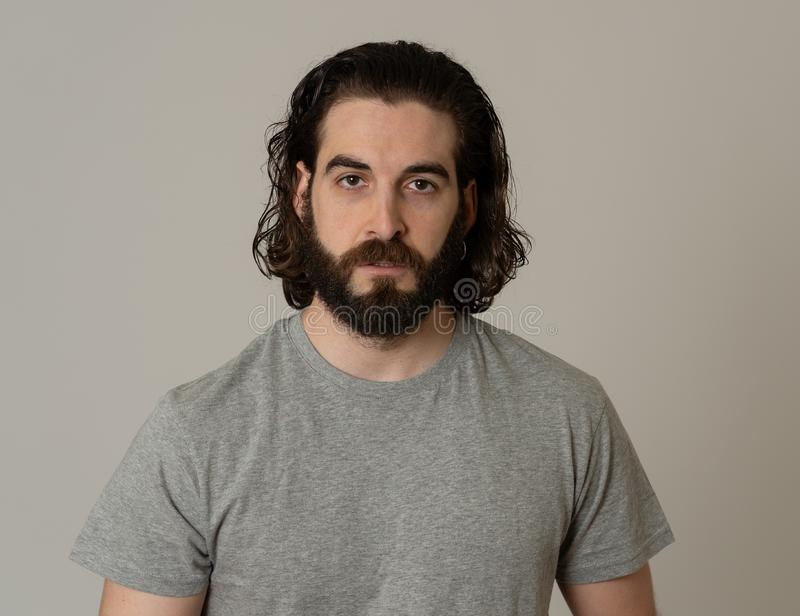 Natural portrait of young attractive man in his 20s looking and posing with neutral face expression. Close up headshot of young Hipster man with natural and royalty free stock photos