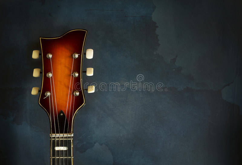 Close-up of headstock old electric jazz guitar stock photography