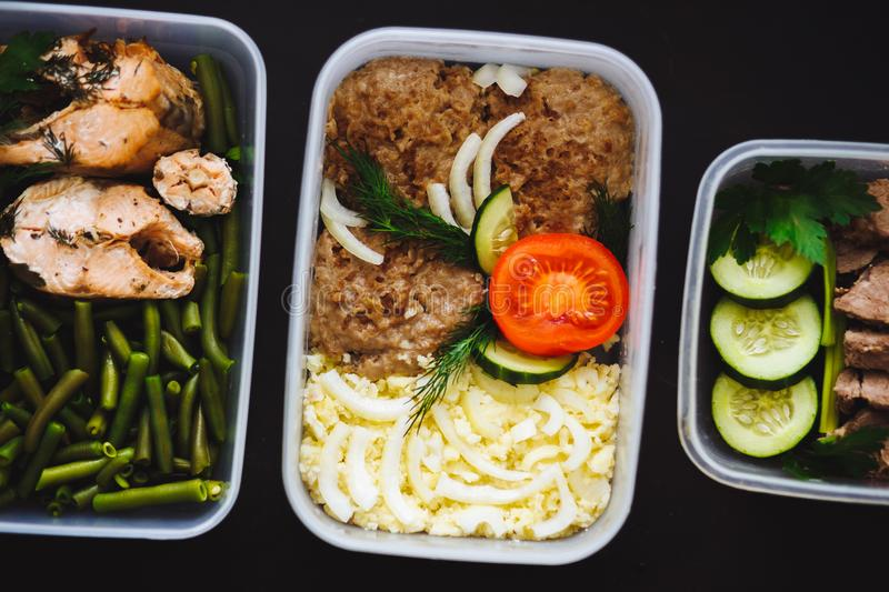 Close up of healthy food in three containers on black background stock photo