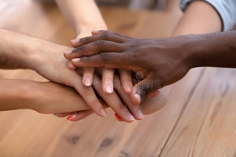 Close up heap of diverse people stacked palms together royalty free stock image