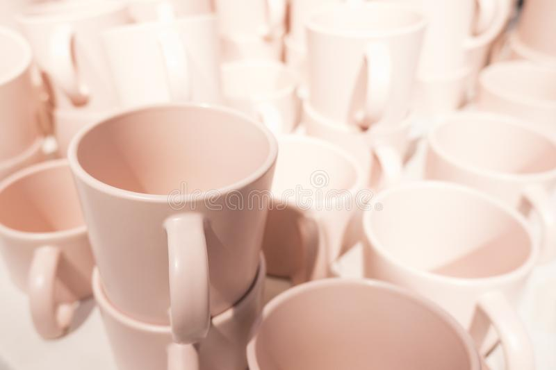 Close up of heap of many cozy soft pink tea cups in a store royalty free stock photography