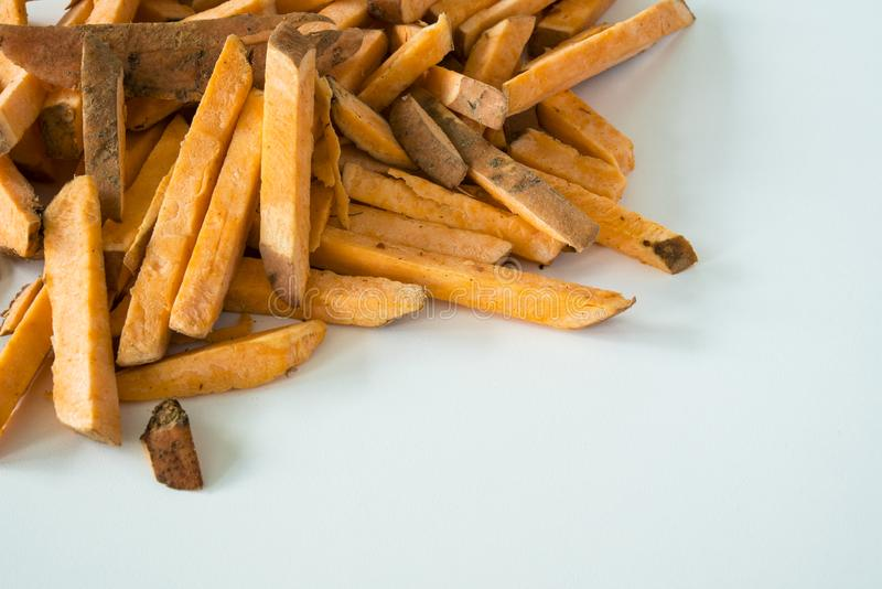 French fries made of sweet potato, on white background royalty free stock photos
