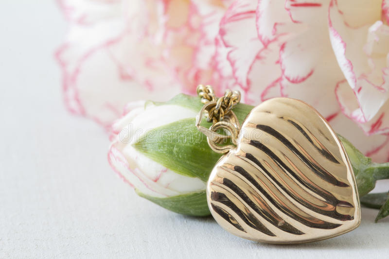 Close Up Heart Locket and Flowers stock photo