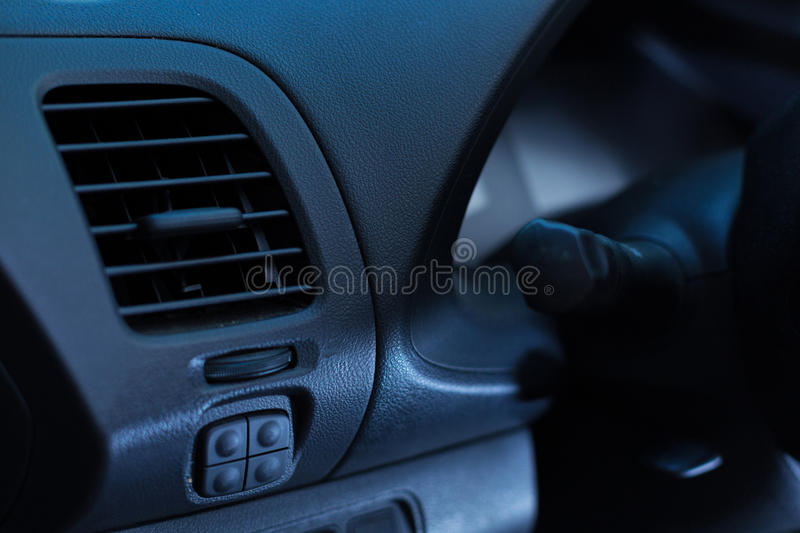 Close up of heat and air conditioning unit of a new car. Best performance. The close up of heat and air conditioning unit being on a black leather head unit royalty free stock photo