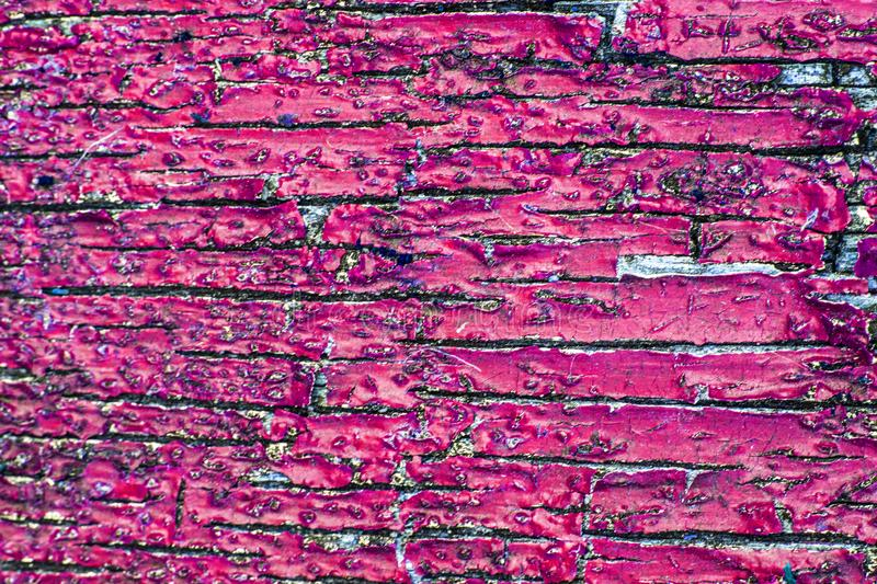 Close Up of a Heavily Weathered and Cracked Painted Wood Door. A Close Up of a Heavily Weathered and Cracked Painted Wood Door royalty free stock photos
