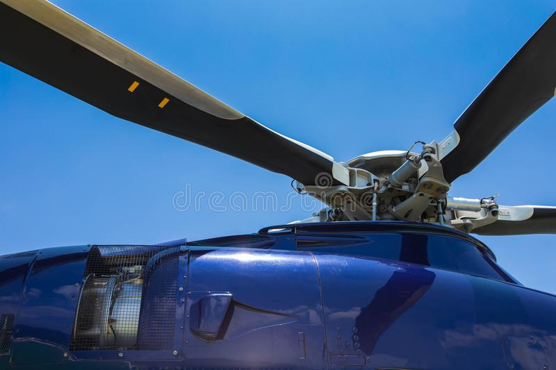 Close up of helicopter head and blades with turbine jet engine stock image