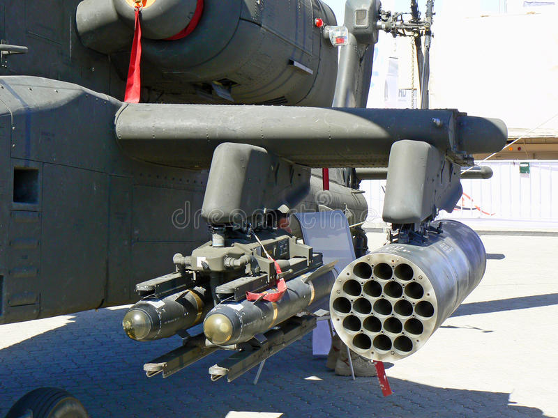 Close up of helicopter weaponry. Close up of weaponry on a helicopter symbolizing conflict, war, the military, coalitions and the desire for world peace stock photo