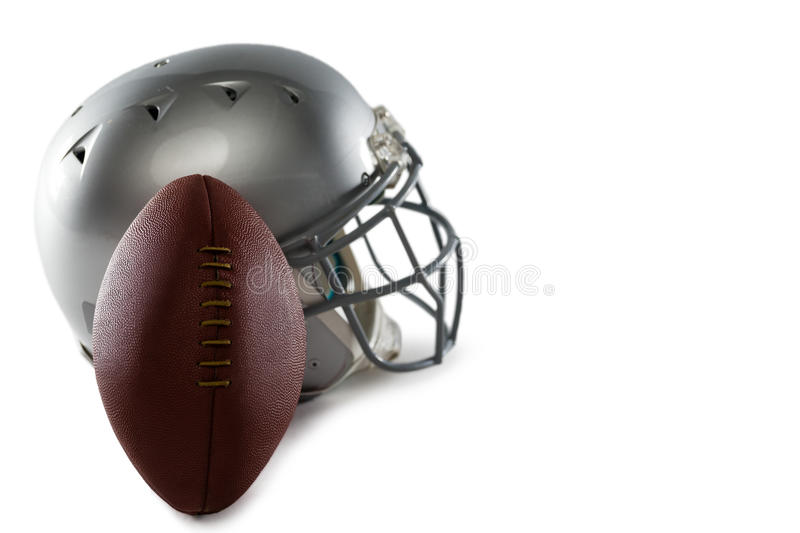 Close-up of helmet and American football. On white background stock image