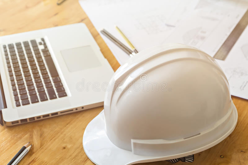 Close up of helmet with architect sketching a construction project stock photos