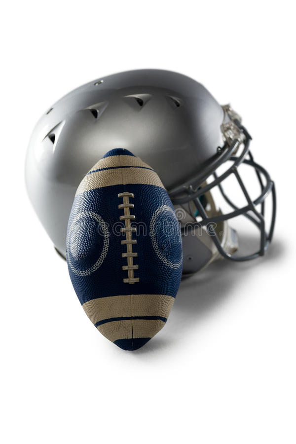 Close-up of helmet and football. On white background stock photos