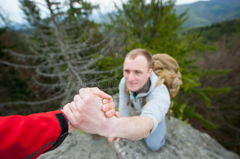 Close-up of helping hand, hiking help each other royalty free stock photos