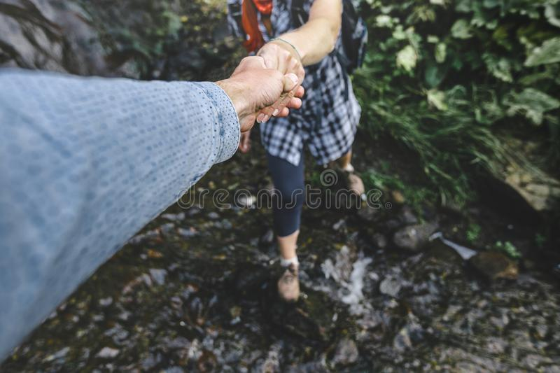 Close-up Of Helping Hand, Hiking Help Each Other. Focus On Hands. People Teamwork Hiking With Motivation And Inspiration. Wide ang stock photo
