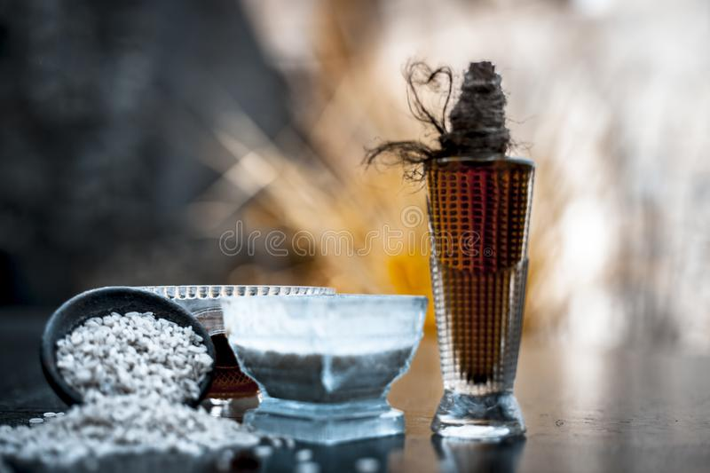 CLose up of herbal face pack of rice flour with castor oil and rose water used to reduce or cleaning acne and pimples in a glass stock image