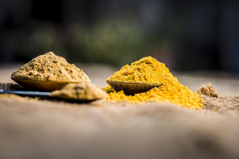 Close up of herbs`s powder and paste i.e mulpani mitti,fuller`s earth , dried orange peel and rose leaves with its extracted water.  stock image
