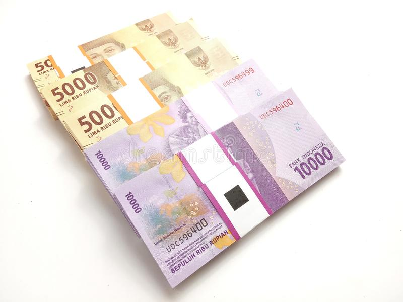 Close Up, High Angle Photo Simple Photo, Top View, Packs of Rupiah Indonesia Money, 2000, 5000, 10000, at white background stock photos