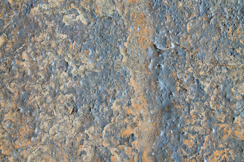 Close up high resolution surface of aged and weathered paint on a wall. Somewhere in europe royalty free stock photos