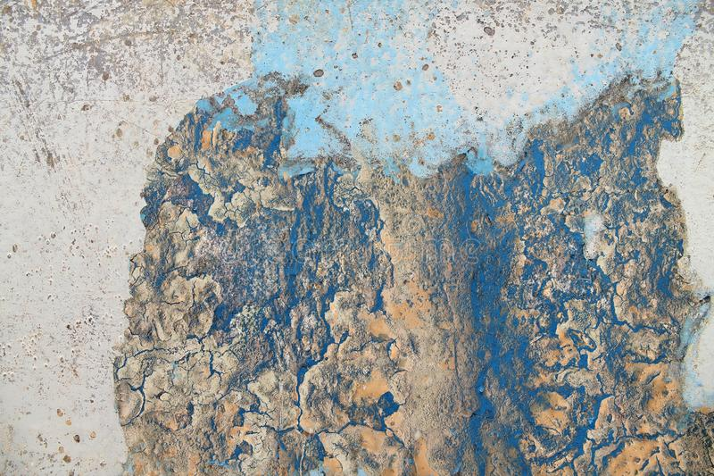 Close up high resolution surface of aged and weathered paint on a wall. Somewhere in europe royalty free stock photography