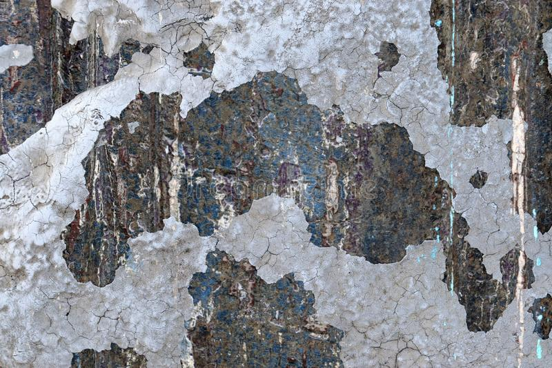 Close up high resolution surface of aged and weathered paint on a wall. Somewhere in europe stock photo