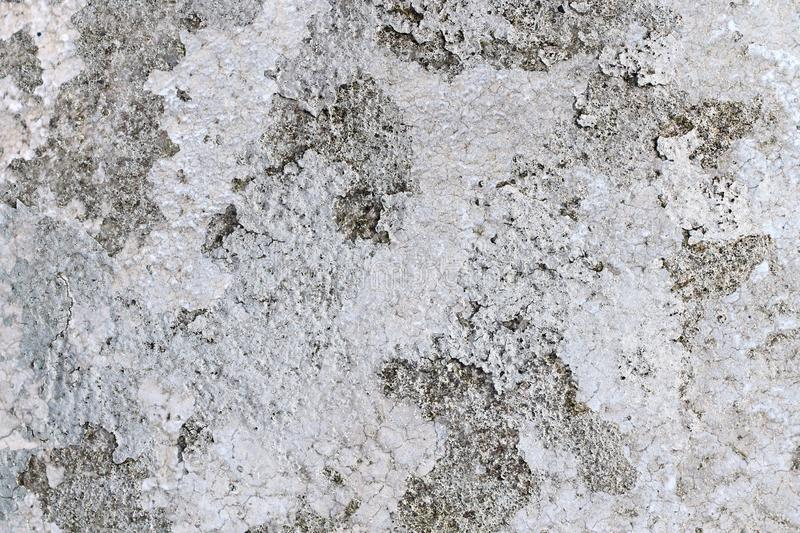 Close up high resolution surface of aged and weathered paint on a wall. Somewhere in europe royalty free stock photo