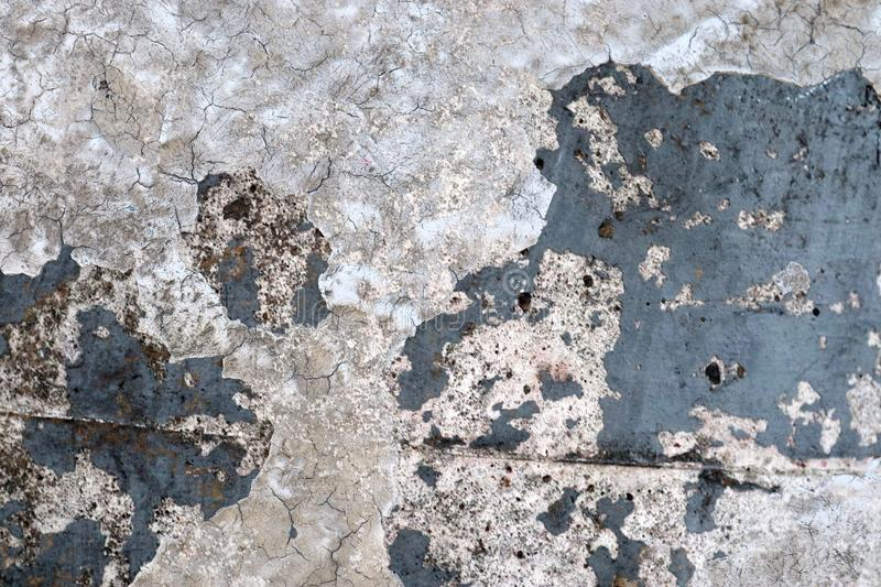 Close up high resolution surface of aged and weathered paint on a wall. Somewhere in europe royalty free stock images