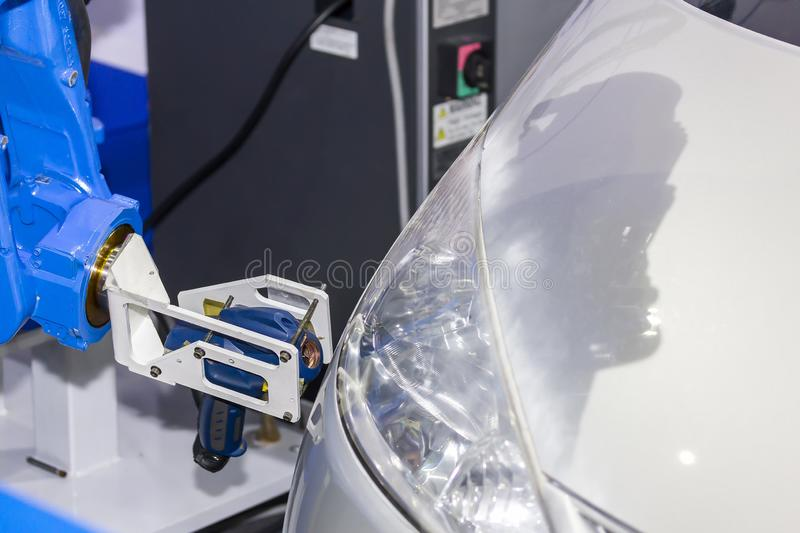 Close up high technology and accuracy equipment robot arm with laser portable 3d scan during inspection automotive part at factory stock photos