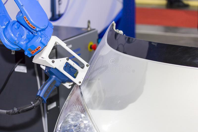 Close up high technology and accuracy equipment robot arm with laser portable 3d scan during inspection automotive part at factory.  stock photography
