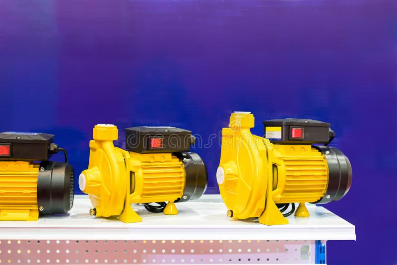 Close up high technology water centrifugal pump for high pressure suction in industrial work on shelf with copy space.  stock photography