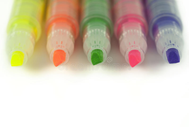 Close up of highlighters isolated on white stock photography