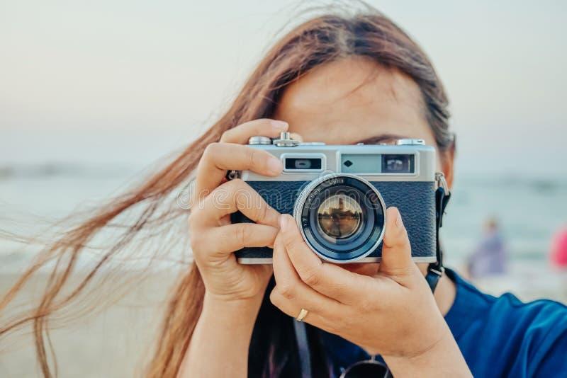 Close up ,hipster long hair woman take a photo stock image