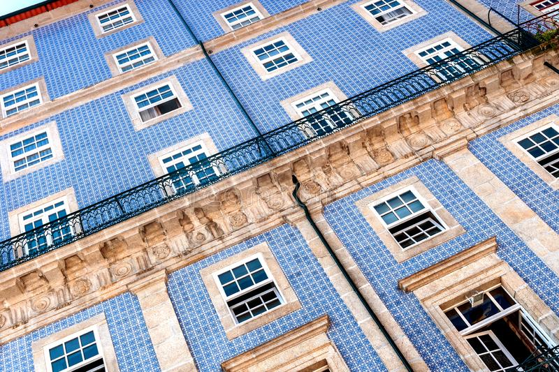 Close-up of a historic building facade in Porto`s old town with the typical blue Azulejo ceramic tiles. Diagonal cutout stock photography