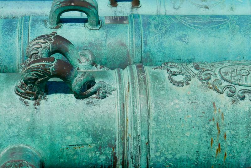 Close up of historic, ornate, turquoise cannons. Close up of intricately decorated teal or turquoise ancient cannons located at the Castillo de San Marcos in St royalty free stock images