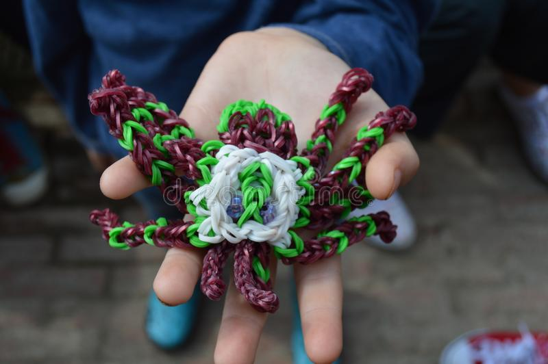 Spider loom band. Close up of a home made spider loom band royalty free stock image