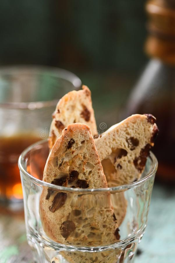 Close up of homemade biscotti or cantucci with raisins in glass served with filtered coffee. Closeup royalty free stock image