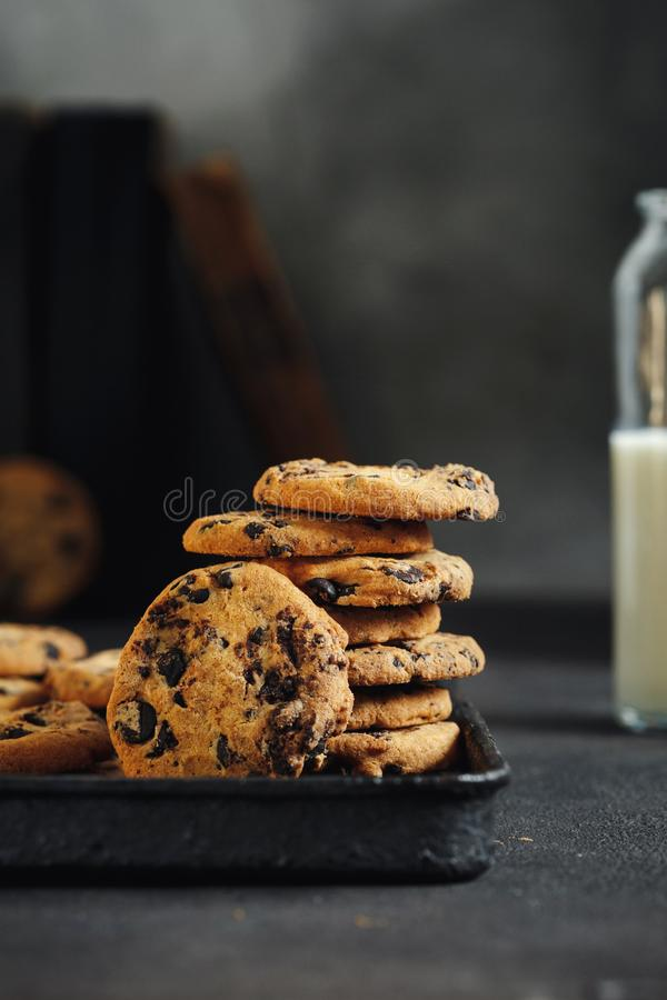 Close up Homemade chocolate cookies baking tray milk royalty free stock photography