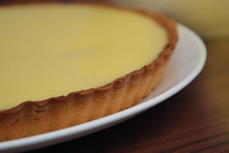 Close Up Homemade Lemon Cheesecake Pie on Dark wooden Background. Food Preparing. step by Step Dessert Cooking Process. royalty free stock images