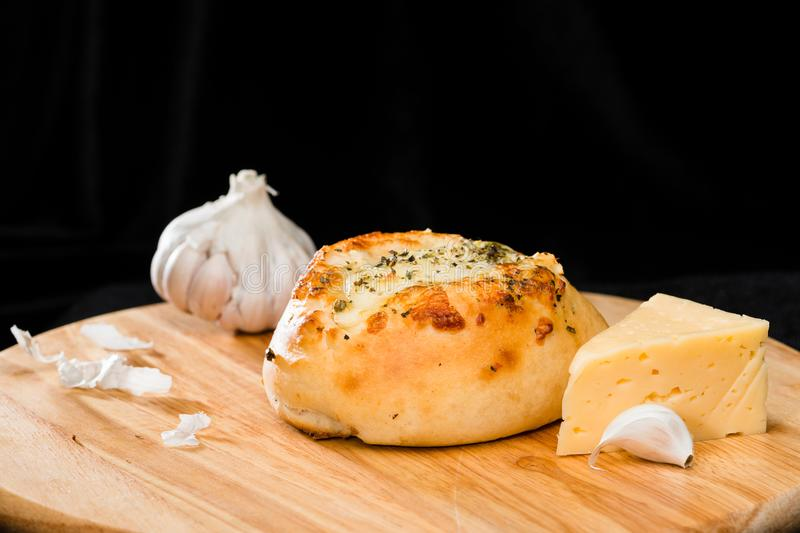 Close-up of homemade mini pizza bun topped with cheese, garlic a stock photos