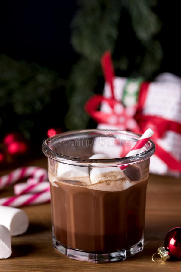 Close Up Homemade Tasty Hot Chocolate in Glass with Marshmallow Festive Christmas Background Candy Cane Vertical stock images