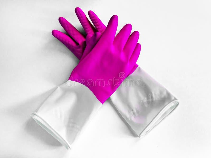 Close-up hoogste mening van mooie roze latexhandschoenen op witte achtergrond Huishoudelijk werkconcept Algemene of regelmatige s royalty-vrije stock afbeeldingen