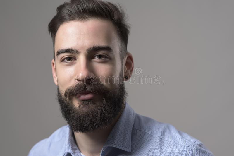 Close up horizontal portrait of stubble bearded smart casual business man with copyspace royalty free stock photos