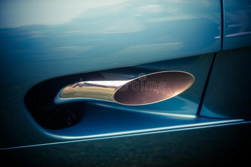 Blue car exhaust pipe stock image