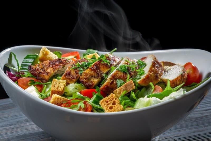 Close-up of hot chicken Caesar salad stock photography