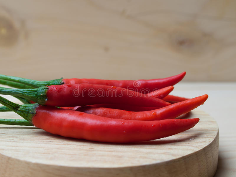 Close up Hot chili peppers. Close up Hot chili peppers Put on wooden floor. with free space for text stock image