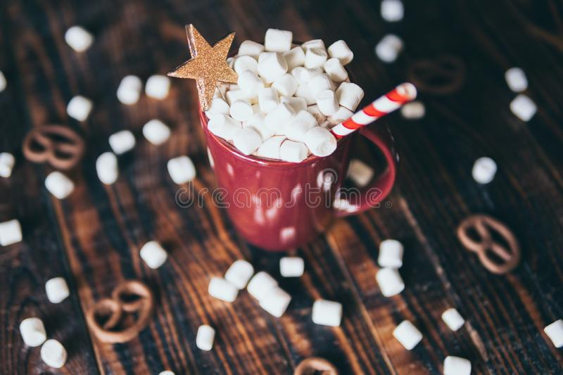 Close-up on hot chocolate mug covered with marshmallow. On dark wood background, gourmet, autumn, coffee, beverage, dessert, closeup, food, cocoa, drink, fall royalty free stock images