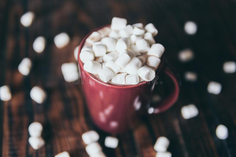 Close-up on hot chocolate mug covered with marshmallow. On dark wood background, gourmet, autumn, coffee, beverage, dessert, closeup, food, cocoa, drink, fall royalty free stock photos