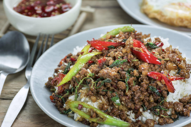 Close-up Hot Rice topped with stir-fried pork and basil food of royalty free stock image